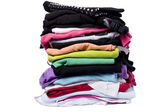Lots of color on white washing and ironing clothes — Stock Photo