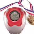 Stopwatch with winning gold medal — Stock Photo