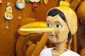 长长的鼻子木制皮诺奇娃娃 — 图库照片