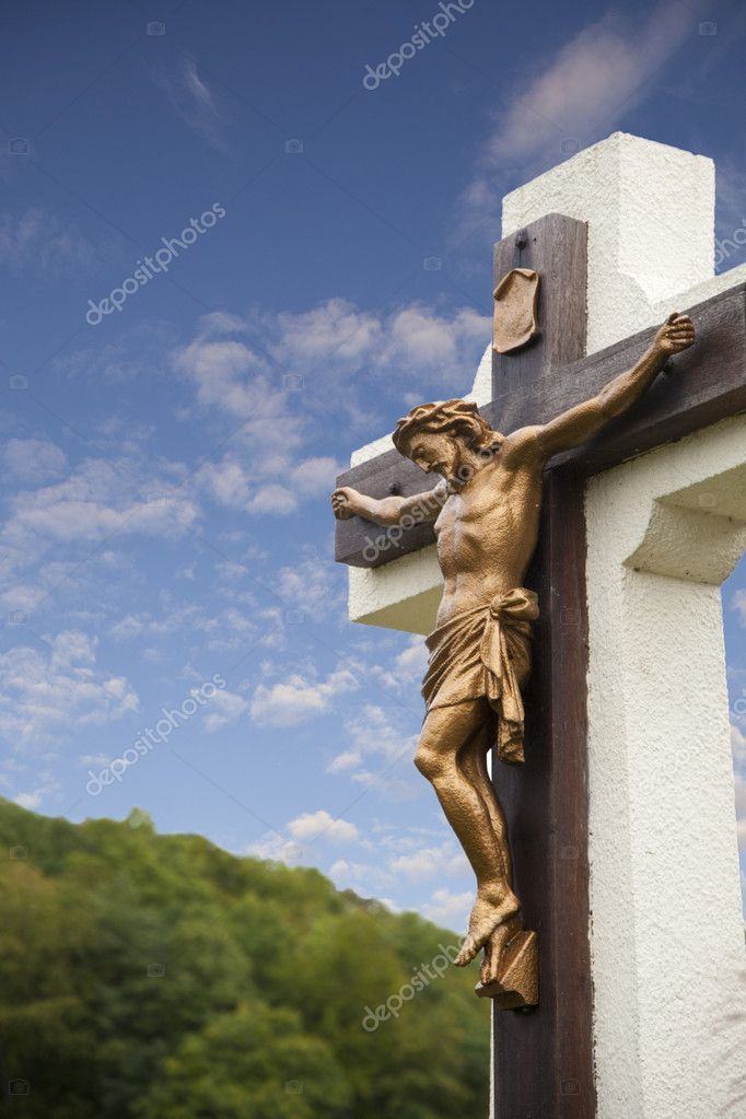 Statue of Jesus on cross with blue sky  Stock Photo #7087493