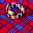 Stock Photo: Colorful Africbracelet with Masai blanket background