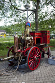 Very old red fire engine on street — Stock Photo