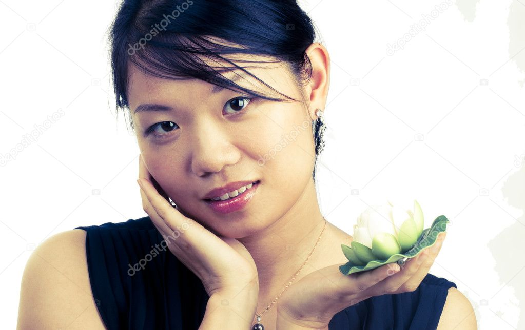 Asian woman holding and smelling beautiful white  lily flower with spa concept isolated  Stock Photo #6853746