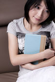 Thinking beautiful girl with the book — Stockfoto