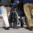 Stroll in a Wheelchair - Stock Photo