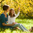 Two sisters in a park in autumn — Stock Photo #6937789