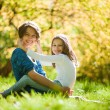 Foto Stock: Two sisters in a park in autumn