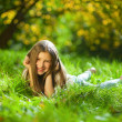 Girl on grass in park — Stock Photo