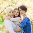 Mother and two daughters in a park — Stock Photo