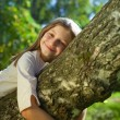 Girl lying on a tree — Stock Photo