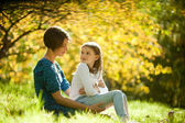 Two sisters in a park in autumn — Stock Photo
