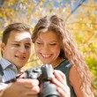 Happy young couple looking at camera — Stock Photo