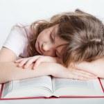 Girl fell asleep with a book — Stock Photo #7558423