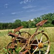 Stock Photo: Traditional rusty horse powered grass mower & haymaker