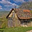 Beautiful scenic old cottage in mountain region — Stock Photo #6961195