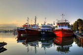 Fishing boats on early morning on calm sea — Stock Photo