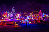 Christmas fantasy - trees and houses in lights — Stock Photo