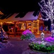 Christmas fantasy - lodge and tree lights - Stock Photo