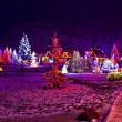 Stock Photo: Christmas lights in town park - fantasy colors