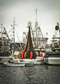 Fisherman crew fixing nets on fishing boat — Stock Photo