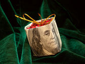 The Christmas toy wrapped in the dollar bill — Stock Photo