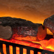 Stock Photo: Artificial fireplace close up