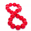 The red bead laid out as a figure eight — Stock Photo