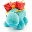Toy of dragon with Christmas gifts on it's back — Stock Photo #7930814