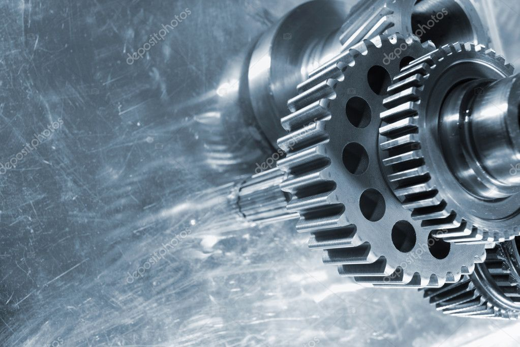 Gears and cogs, used in aerospace industry, mirrored in aluminum background — Stock Photo #6896668