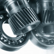 Ball bearings, gears against brushed aluminum — Stock Photo