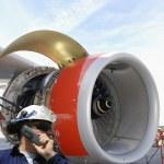 Mechanic and jet engine — Stock Photo #7054155