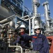 Stock Photo: Oil workers inside chemical refinery