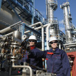 Oil workers inside chemical refinery — Stock Photo #7284125