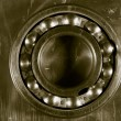 Stock Photo: Ball bearing and steel background