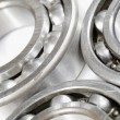 Ball bearings set against white background — Stockfoto