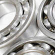 Ball bearings set against white background - Stock Photo