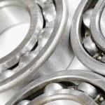 Ball bearings set against white background — Stock Photo