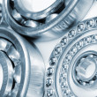 Stock Photo: Ball bearings set against white background