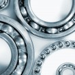 Stock Photo: Ball bearings against whites