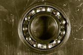 Ball bearing and steel background — Stock Photo