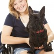 Disabled Girl with Scotty Dog - Stockfoto