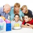 Family Blows Out Birthday Candles — ストック写真