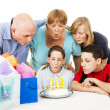 Family Blows Out Birthday Candles — Stok fotoğraf