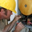 Stock Photo: Air Conditioning Repairman Working