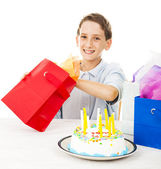 Little Boy Opens Birthday Gift — Stock Photo
