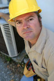 Serious Looking AC Tech — Stock Photo