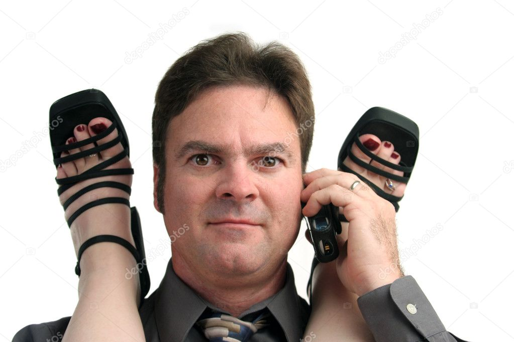 A man in the middle of an office affair receiving a phone call.  Stock Photo #6778927