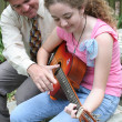 Stock Photo: Father Daughter Guitar Lesson