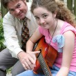 Father Daughter Guitar Lesson — Stock Photo #6781637