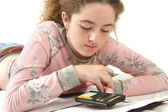 Adolescente fazendo lição de casa — Fotografia Stock